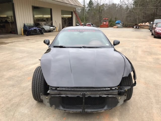 Black Maserati with front bumper removed